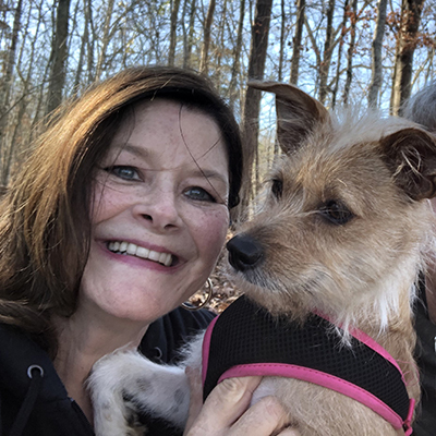 Patricia Forehand Smiling With Her Dog